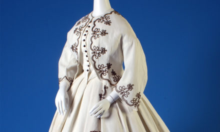 1867 – White piqué afternoon dress with black cording