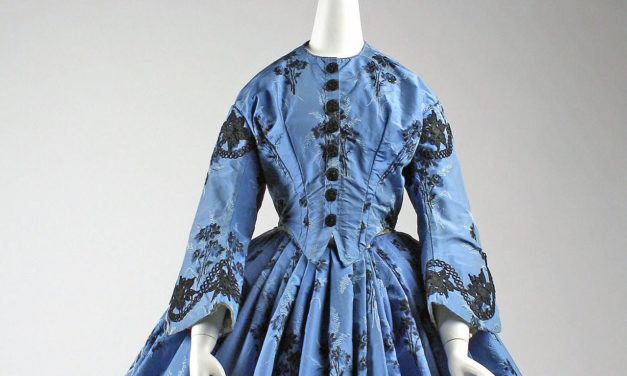 1863 – Blue silk dress with black floral embroidery