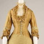 1876-77 – Brass-colored silk day dress