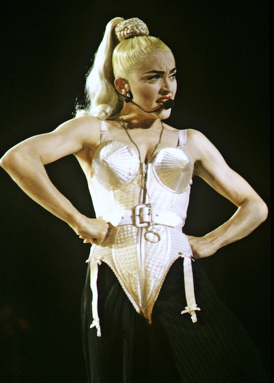 Madonna during the Japanese leg of her Blonde Ambition World Tour wearing a similar design by Gaultier.