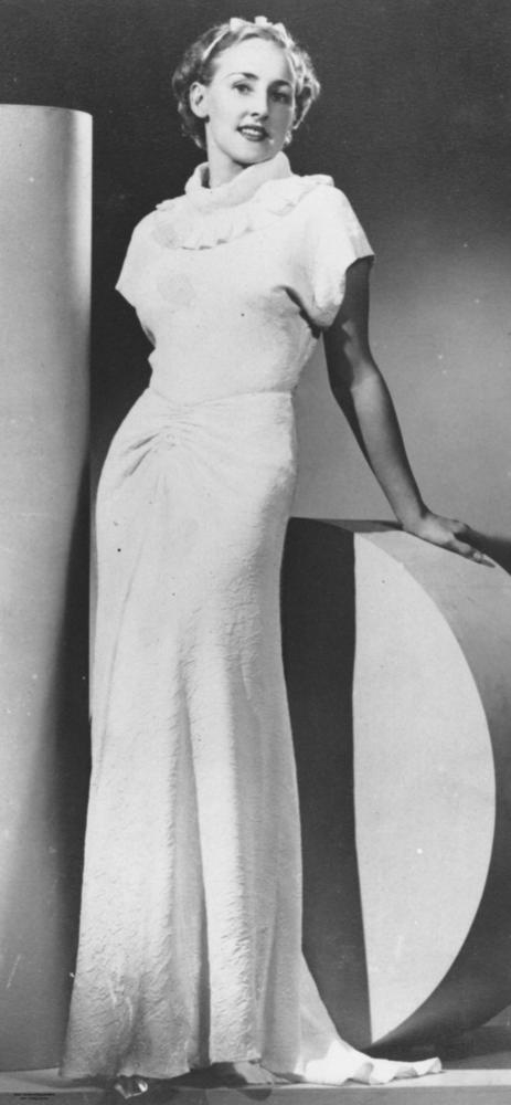 Model posing in a glamorous evening gown