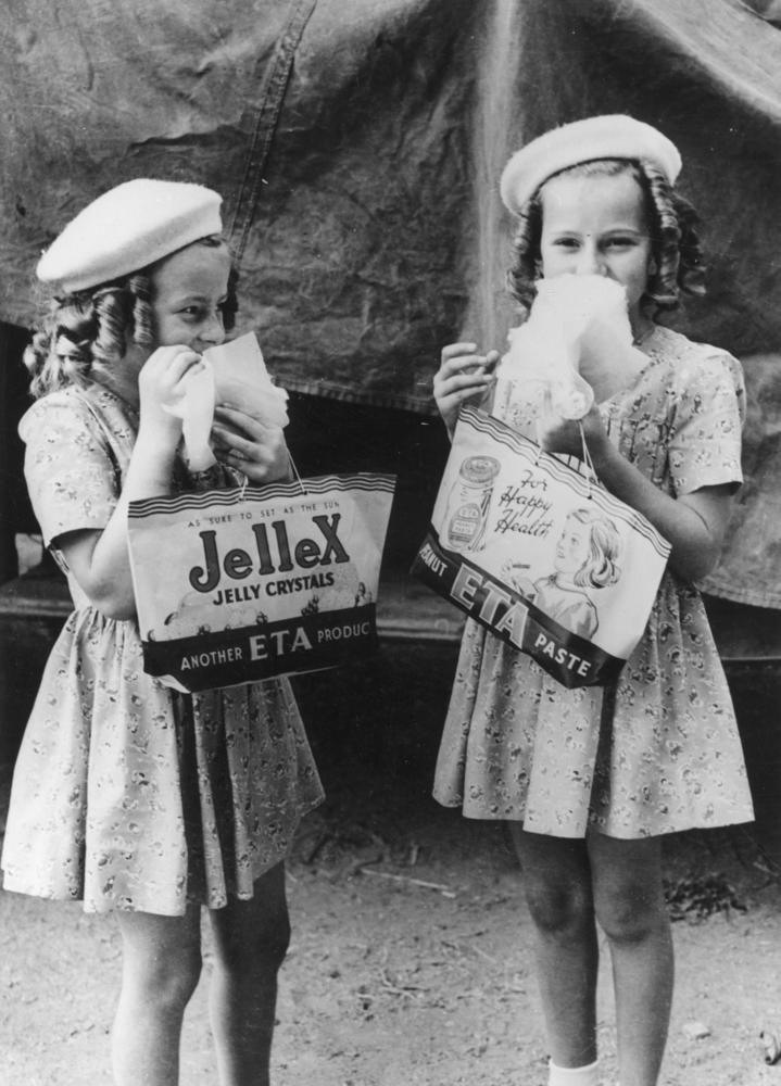 Two young girls enjoying themselves at the RNA Show, Brisbane, 1946
