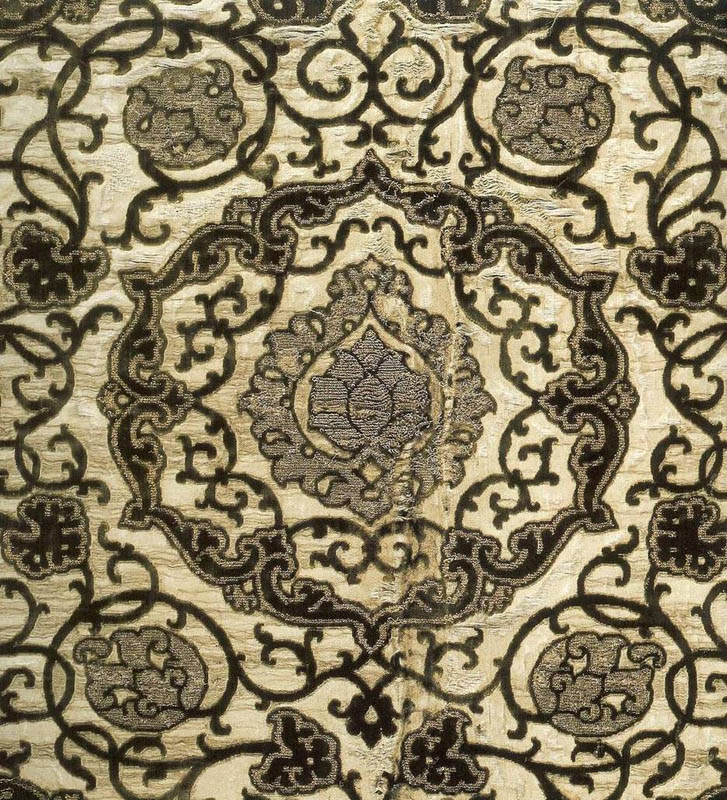 Patterned velvet on silver ground with silver and gold brocade effect