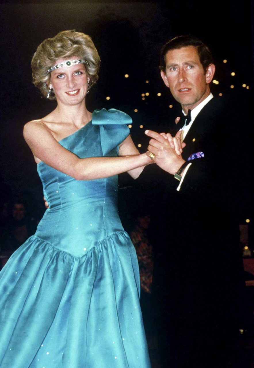 Prince Charles Dancing With His Wife, Princess Diana, In Melbourne, During Their Official Tour Of Australia. The Princess Is Wearing A Diamond And Emerald Choker (a Wedding Gift From The Queen) As A Headband With A One-shouldered Turquoise Satin Organza dress Designed By David And Elizabeth Emanuel