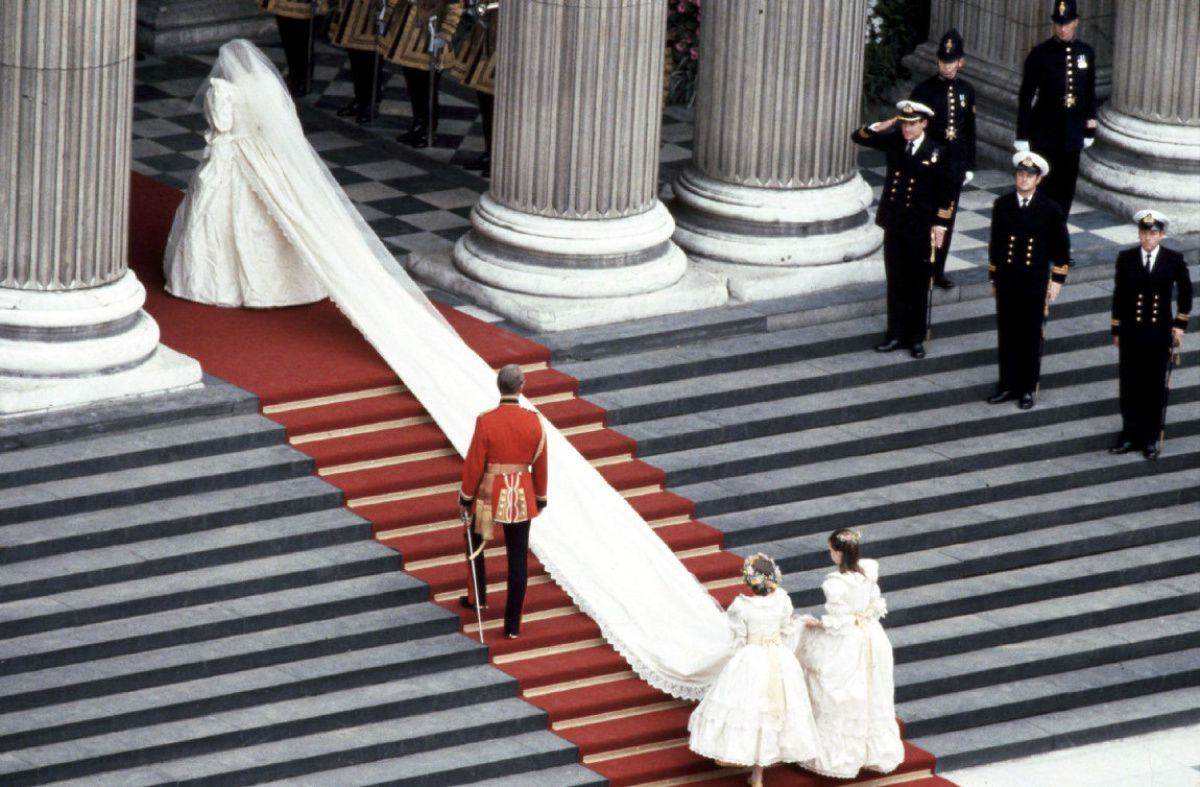 Diana Princess of Wales enters the church with her 25-foot train trailing behind her.